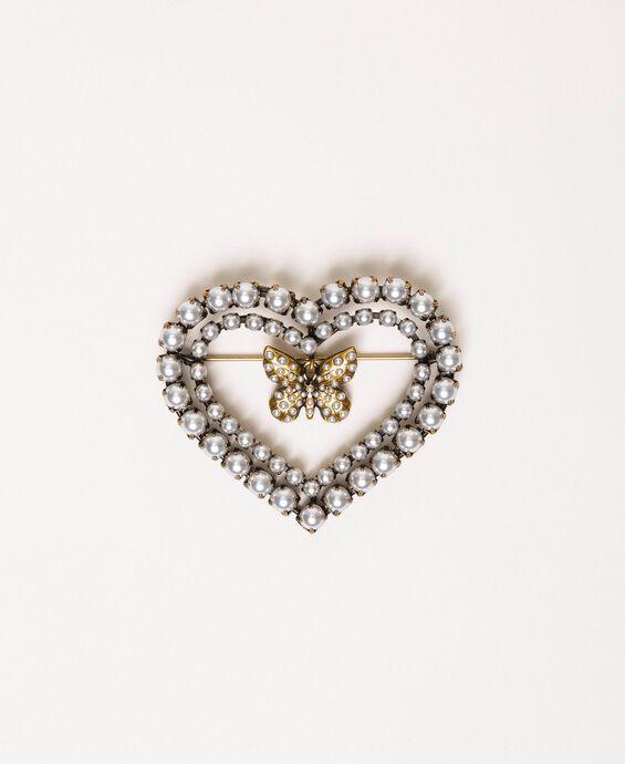 Broche en forme de cœur ornée de perles et d'un papillon