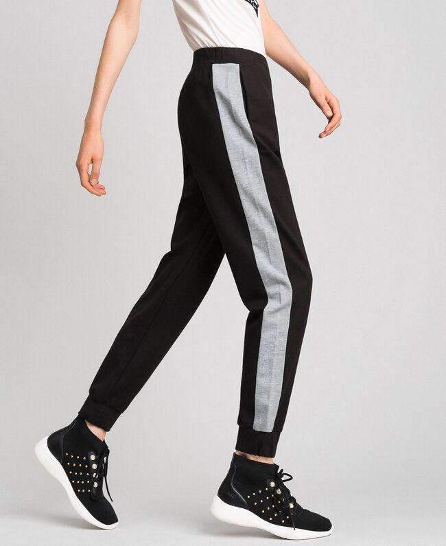 Pantalon de jogging avec bandes contrastées Noir / Gris Chiné Femme 192LI2HDD-04