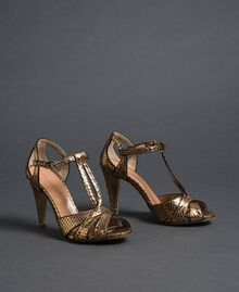 Laminated animal print sandals Gold Python Print Woman 192TCT038-01