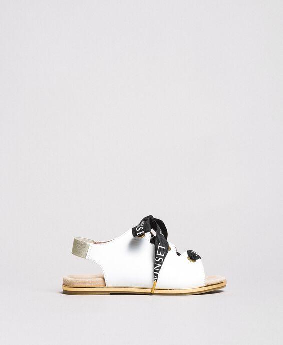 Sandales à lacets griffés