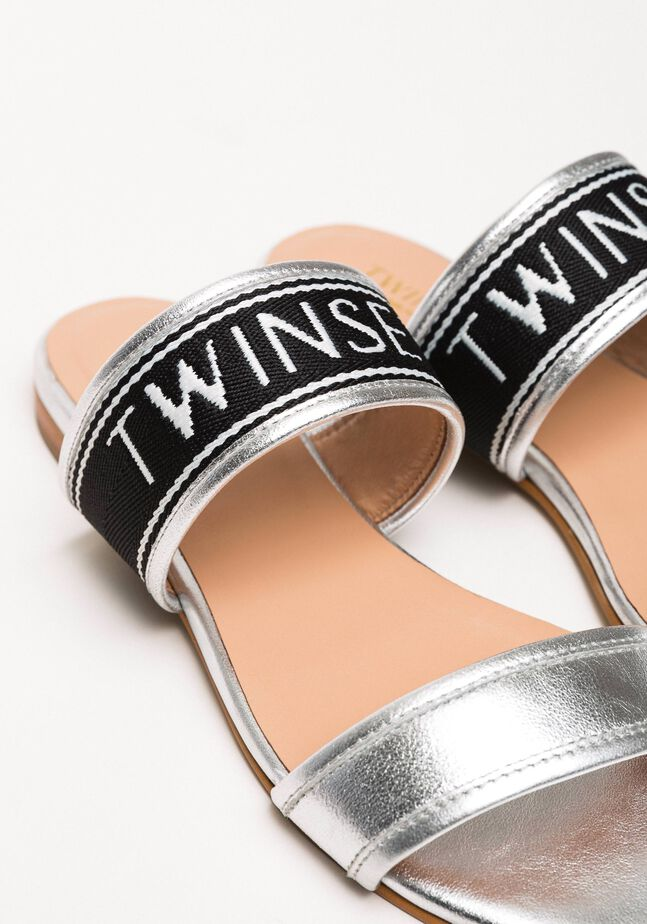 Laminated leather flat sandals with logo