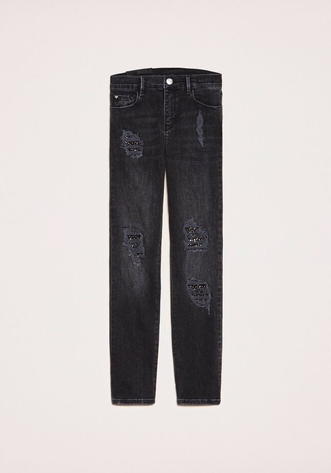 Push up jeans with rips and studs