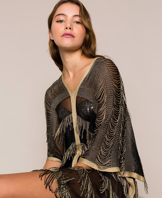 Lurex knit poncho with fringes