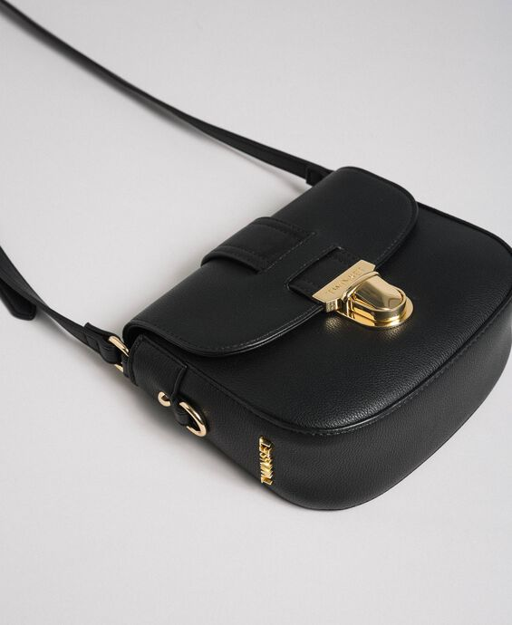 Faux leather shoulder bag with flap