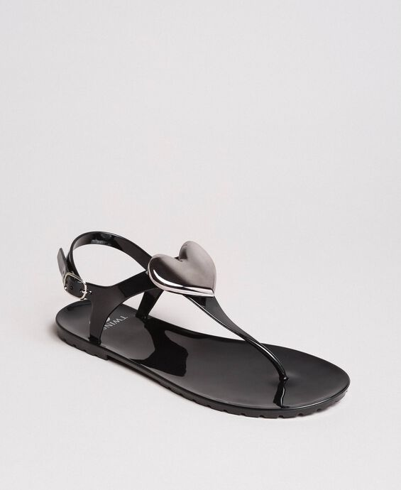 Thong sandals with metal heart