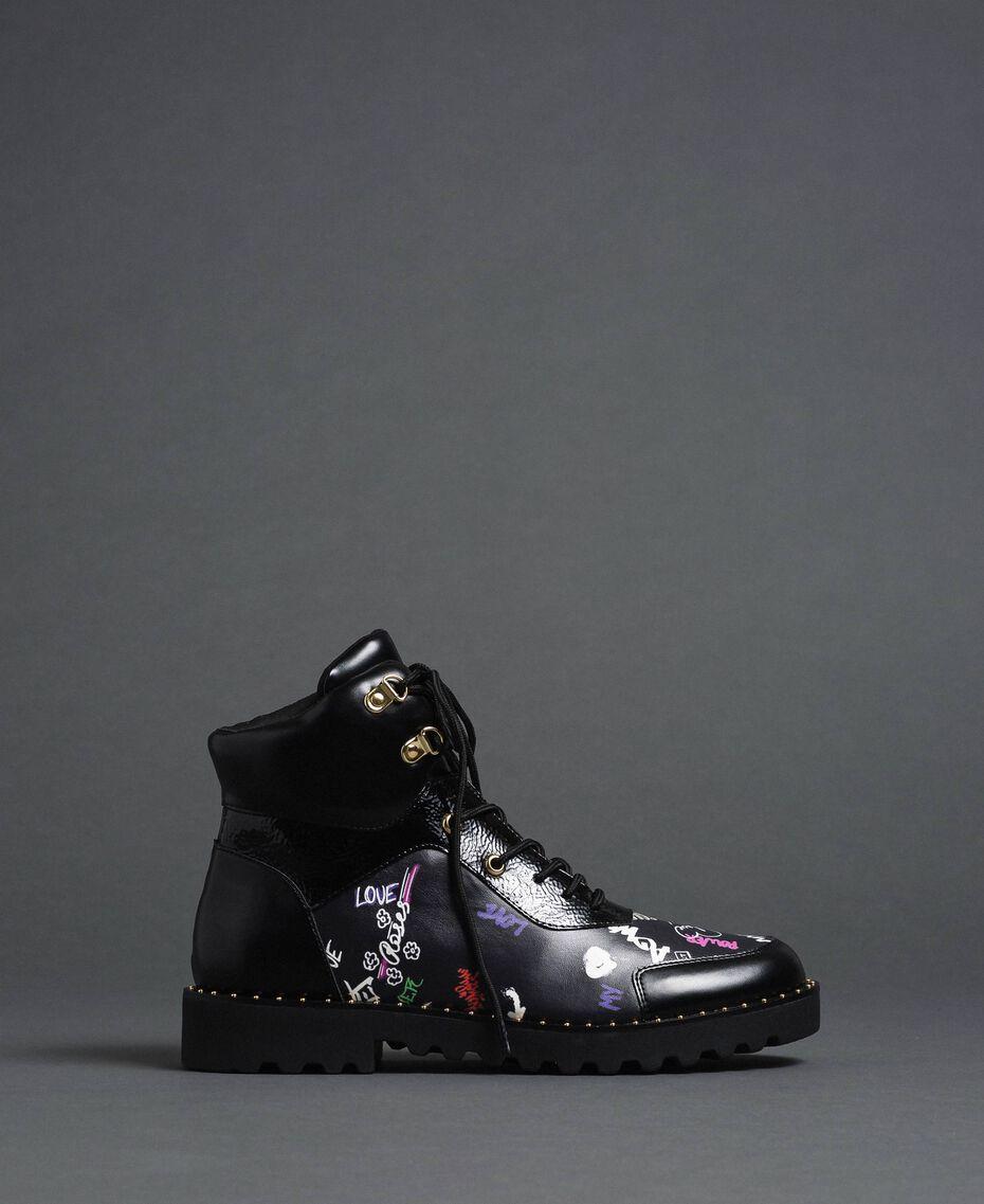 Faux leather combat boots with graffiti print Black Graffiti Print Woman 192MCP09G-02
