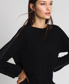 Kleid mit Lurexstreifen und Unterkleid Schwarz Frau 192MP3100-01