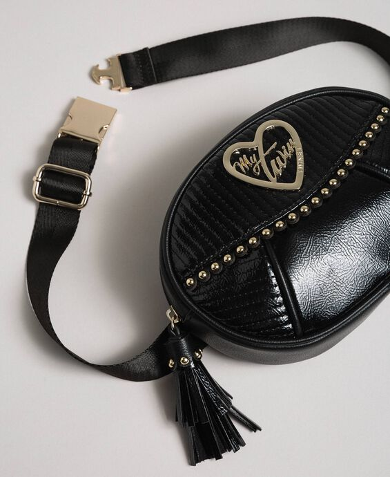 Faux leather belt bag with studs and tassel