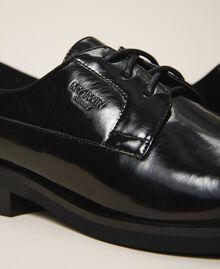 Туфли на шнуровке с декорированным каблуком Черный женщина 202MCT100-04
