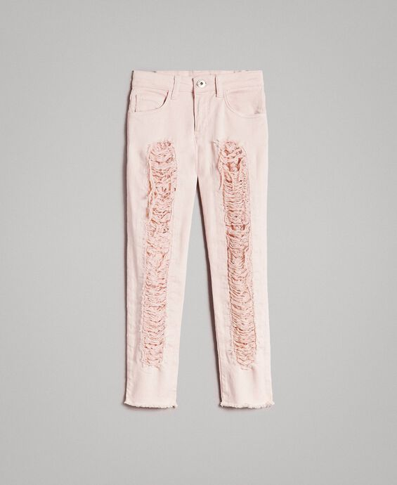Skinny bull trousers with ripped details