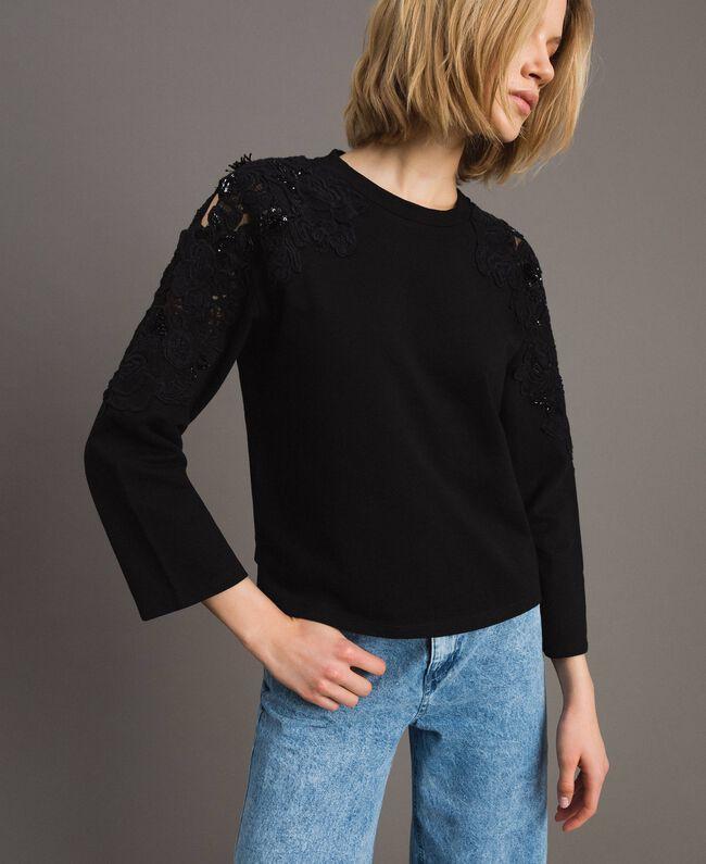 Sweatshirt mit Blumenstickapplikationen Schwarz Frau 191TT2210-01