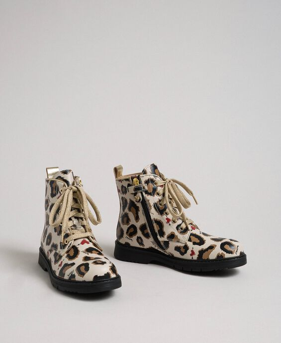 Leather combat boots with animal print