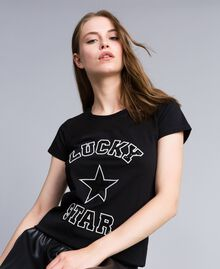 T-shirt in jersey con paillettes Nero Donna JA82MT-01