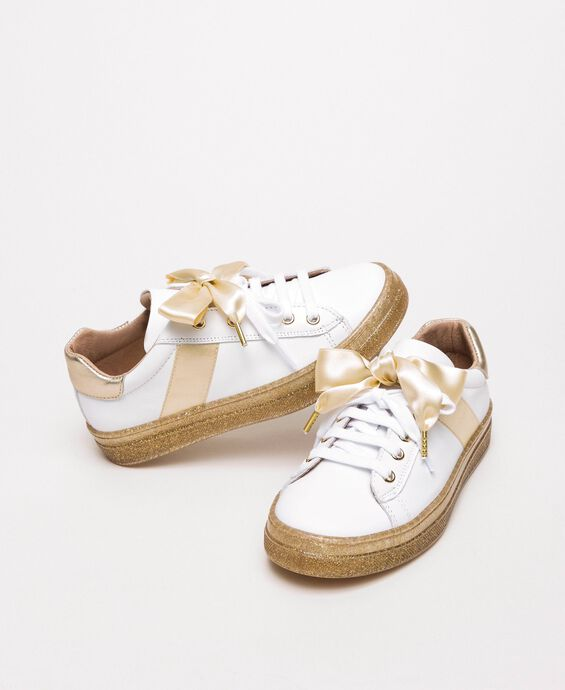 Leather trainers with satin bow