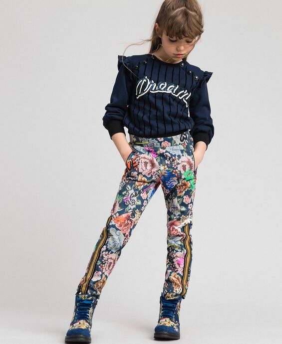 Scuba trousers with floral and graffiti print