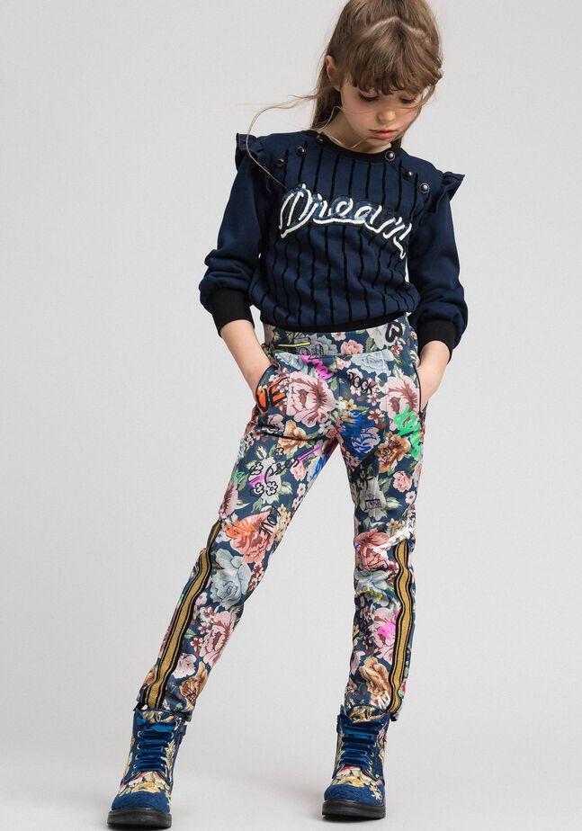 Pantalon en scuba avec imprimé floral et graffiti