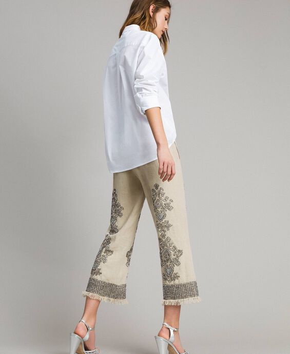 Pantaloni in lino con perline e paillettes