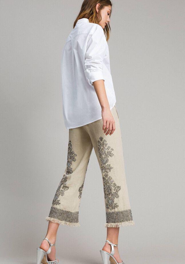 Pantalon en lin orné de perles et de sequins