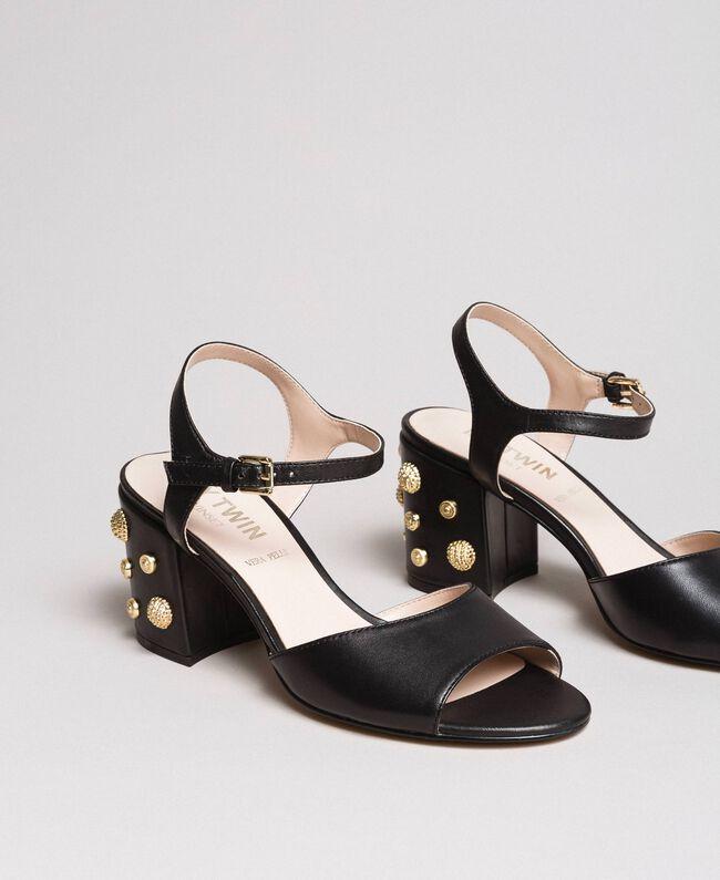 Kunstleder-Sandalen mit Schmuckabsatz Schwarz Frau 191MCP04A-01