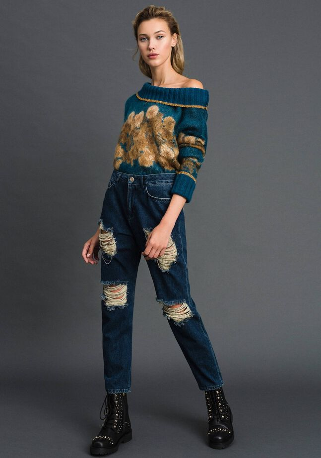 Girlfriend jeans with rips and chains