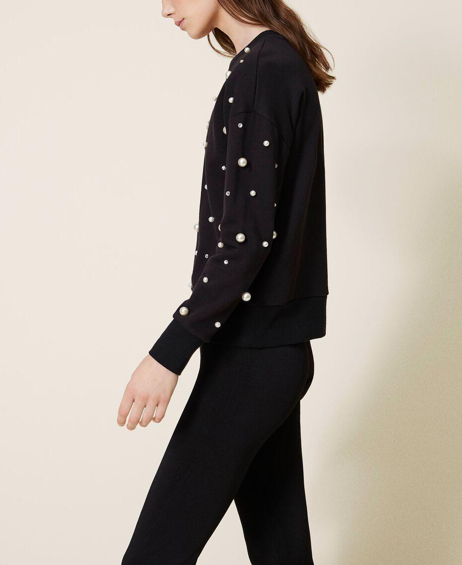 Sweatshirt mit aufgestickten Perlen Schwarz Frau 202TT2T51-02