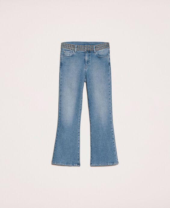 Расклешенные джинсы с заклепками