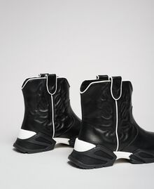 Hohe Cowboy-Sneakers mit Stickereien Schwarz Frau 192TCT114-03