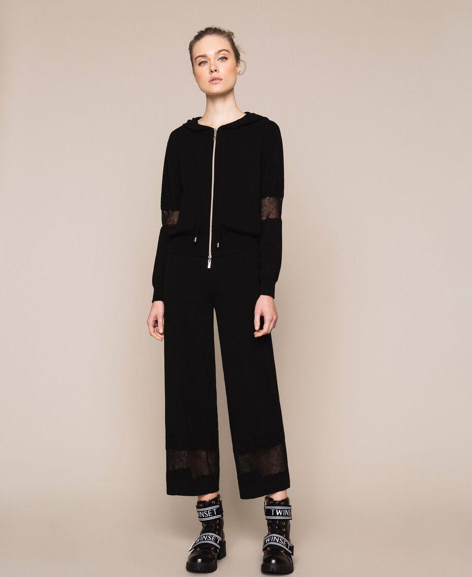 Pantaloni in maglia con pizzo Nero Donna 201LL3GBB-02