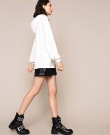 Длинная трикотажная кофта с логотипом Лилия женщина 201MP3210-03