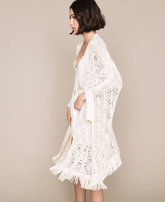Crochet poncho cardigan with fringes