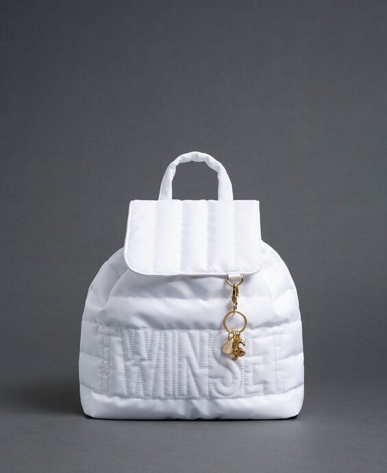 Quilted backpack with charms and logo