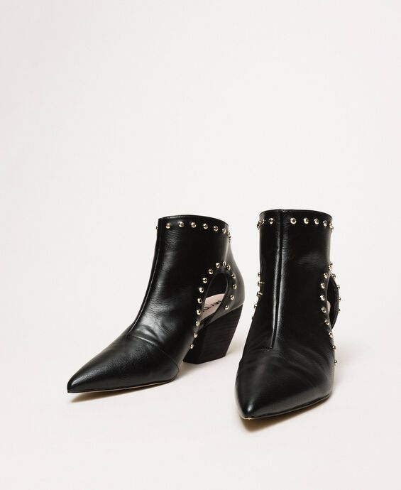 Ankle boots with cutout and studs