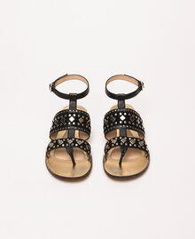 Flache Sandale aus Leder mit Nieten Schwarz Frau 201TCT04A-04