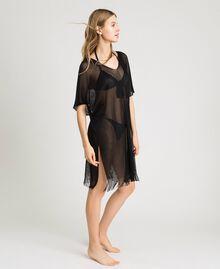Glossy yarn poncho with fringes Black Woman 191LB44CC-02