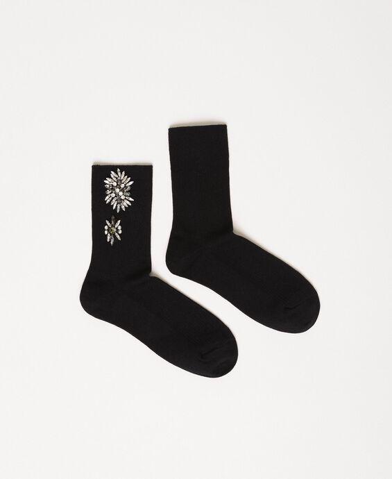 Socken mit Blumenstickerei