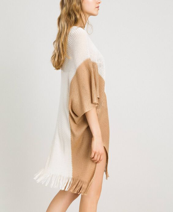 Knitted poncho with fringes