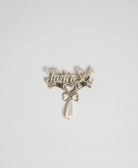 Rhinestone logo and pendant brooch