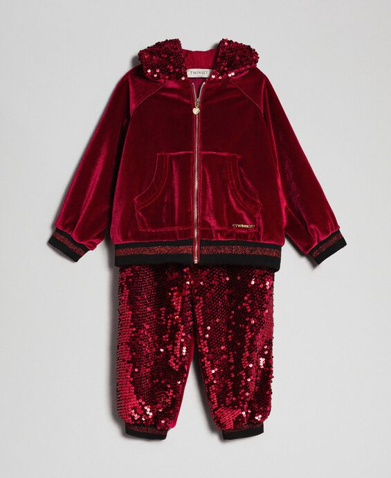 Velvet sweatshirt and sequin trousers