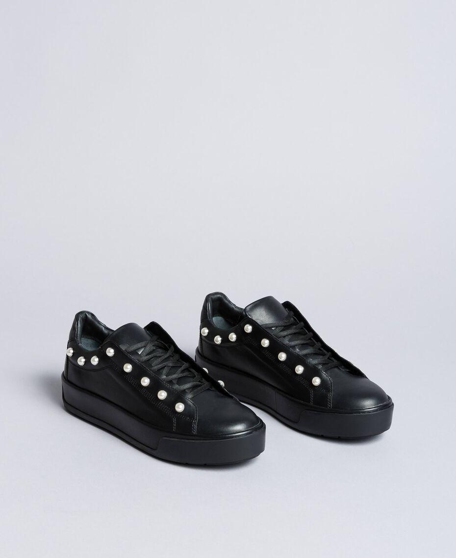Sneakers aus Leder mit Zierperlen Schwarz Frau CA8PBU-02