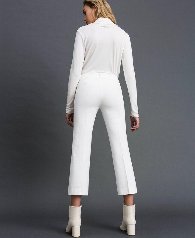 Расклешенные брюки Белый Снег женщина 192TP2092-04