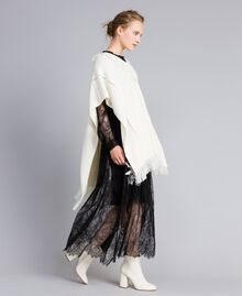 Knitted poncho with fringes White Snow Woman PA83LN-0T