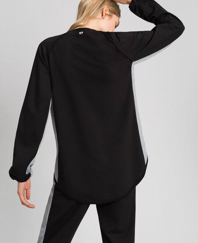 Sweatjacke mit Reißverschluss und Kontrastdetails Schwarz / meliertes Grau Frau 192LI2HEE-03