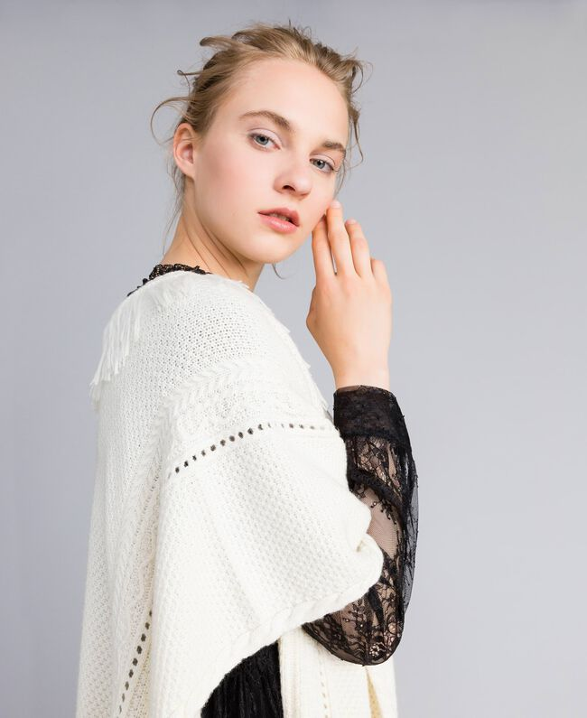 Knitted poncho with fringes White Snow Woman PA83LN-04
