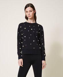 Sweatshirt mit aufgestickten Perlen Schwarz Frau 202TT2T51-04