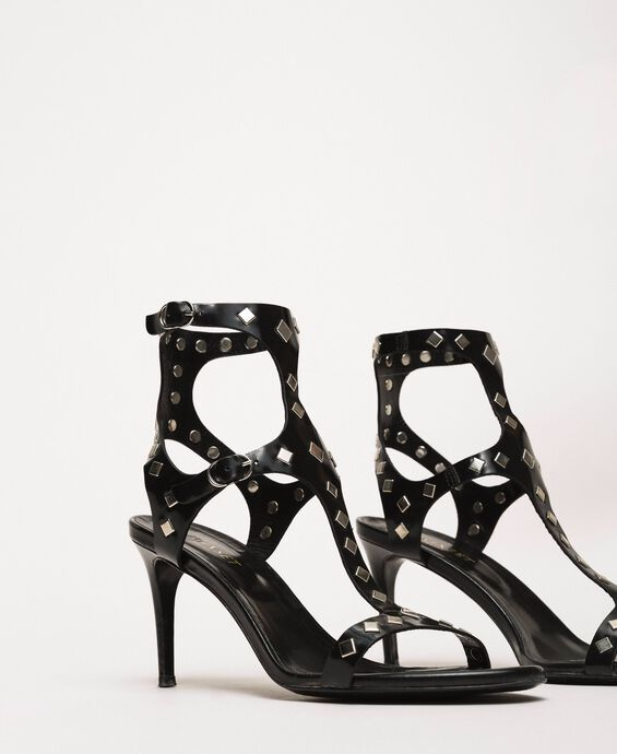 Laminated leather sandals with studs