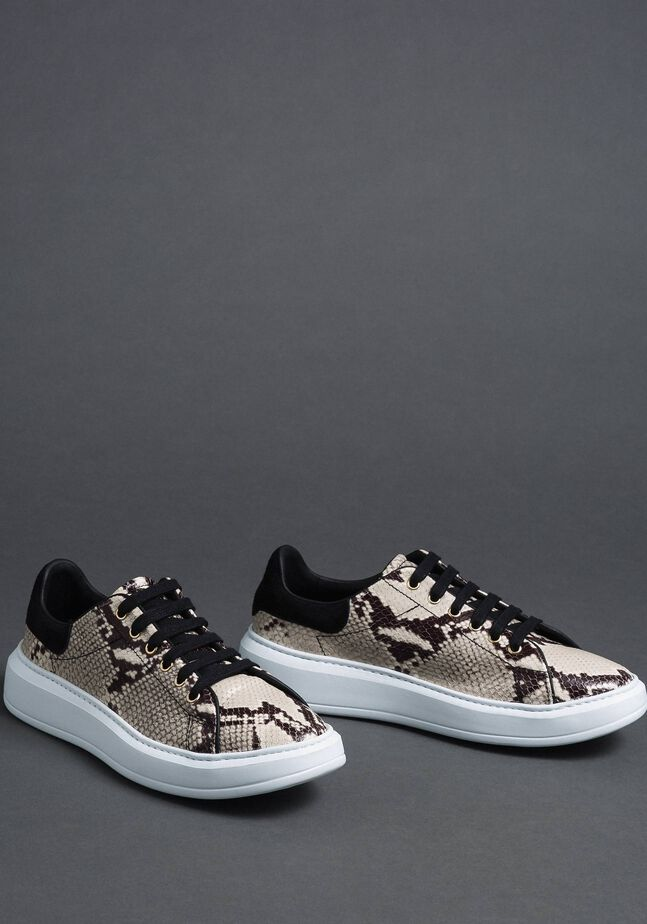Leather trainers with animal print
