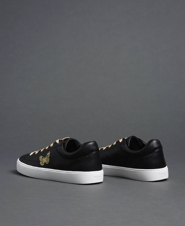 Leather trainers with butterfly embroidery Black Woman 192TCP06A-04