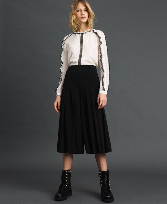Trouser-skirt with pleats and logo