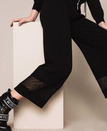 Pantaloni in maglia con pizzo Nero Donna 201LL3GBB-04