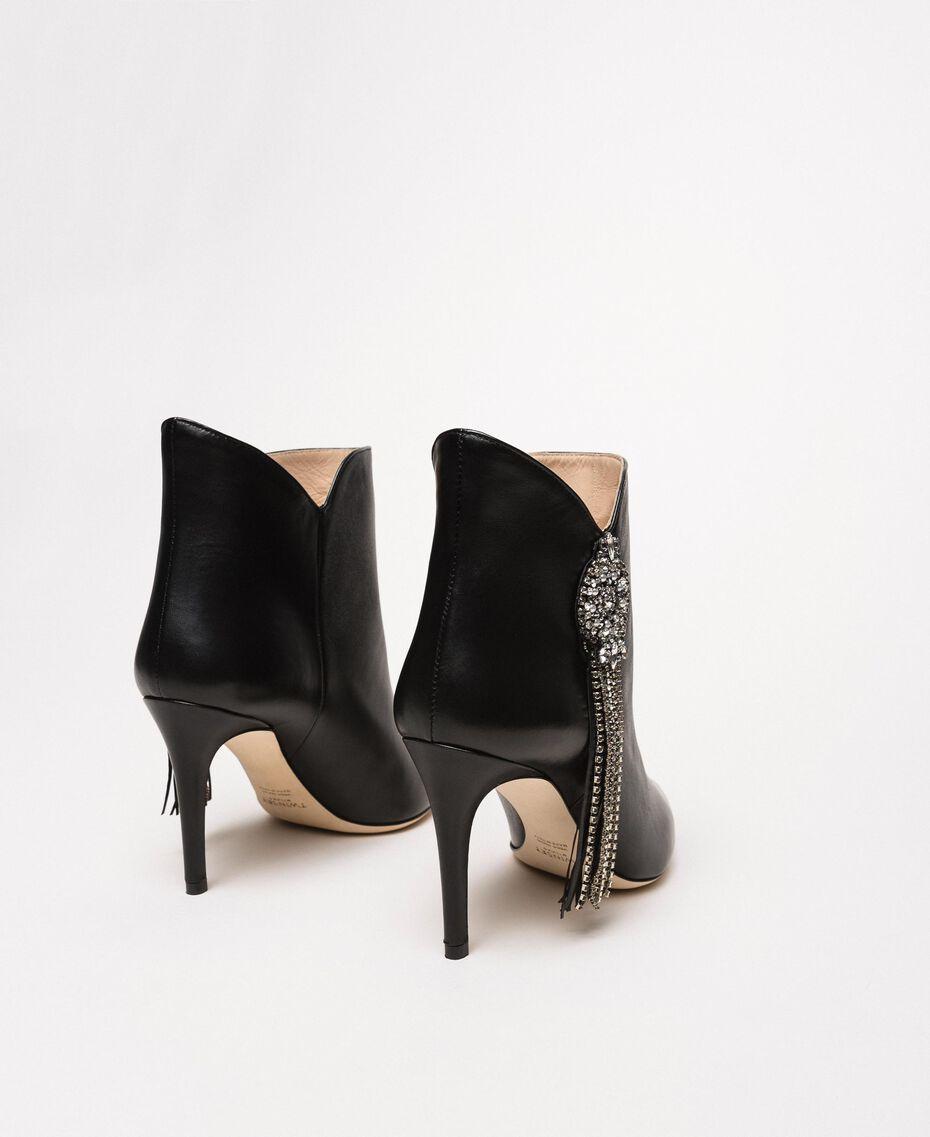Bottines en cuir avec décoration bijou et franges Noir Femme 201TCP030-03